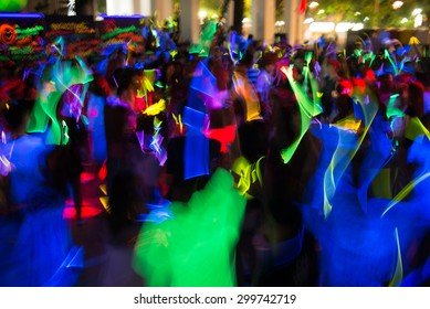 People dancing in a glow in the dark party