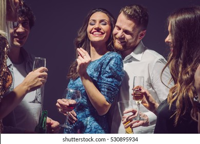 People dancing and having fun at home party.
