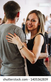 people dancing the kizomba dance on the dance floor in a very tight position