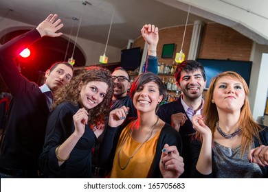 People dancing on a disco pub - Stock Image