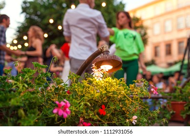 People dancing salsa and bachata in outdoor cafe in Lviv