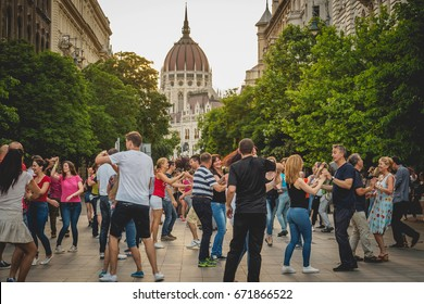 People dancing in the street during a food festival in Budapest (Hungary). June 2017.