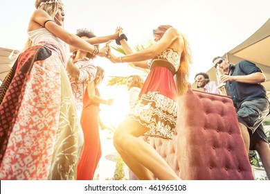 People dancing while dj and musician with sax playing good music