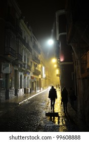 People in the dark alley