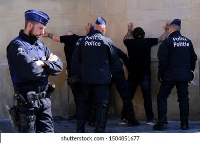 People are detained by the police officers ahead of a far-right demonstration against the absence of  nationalist party Vlaams Belang in the upcoming  government in Brussels, Belgium, Sep. 15, 2019