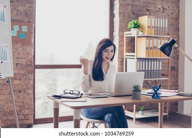 People development start-up  confirmation brainstorm play game gamer rest relax break pause concept. Attractive cheerful joyful glad trainee looking at monitor and rejoicing at modern workstation