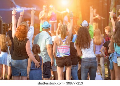 People of different ages enjoying an outdoors music, culture, community event, festival