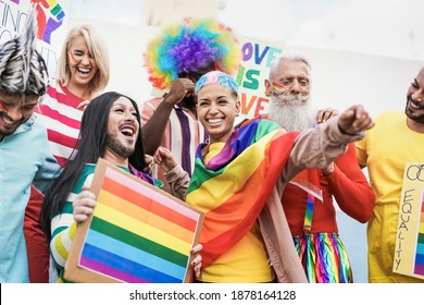 People from different generations have fun at gay pride parade with banner - Lgbt and homosexual love concept