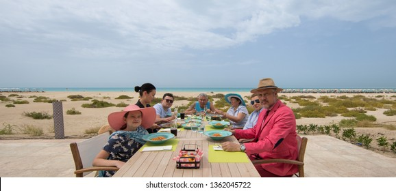 people dine in the restaurant at the outdoor dining table