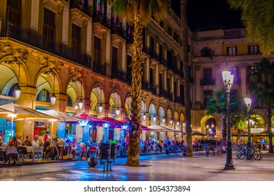 People dinning in a restaurant situated on the Placa Reial  in Barcelona, Spain.