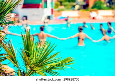 People doing acquagym in a resort