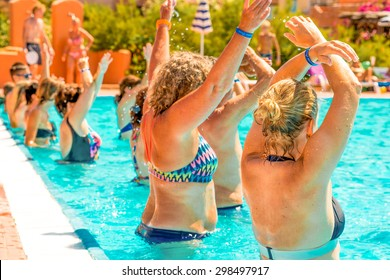 people doing acquagym in a resort pool