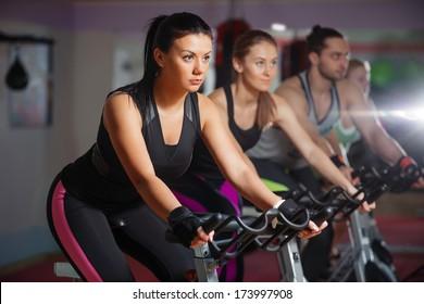 People doing indoor biking in a fitness club