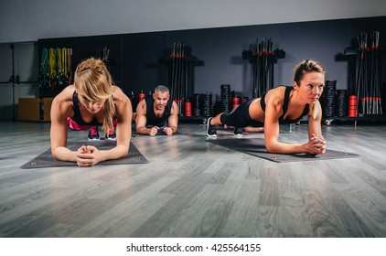 People doing push ups in fitness class