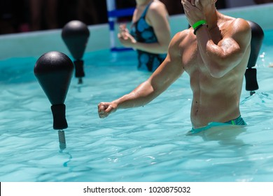 People Doing Water Aerobics with Boxing Speed Ball in an Outdoor Swimming Pool.