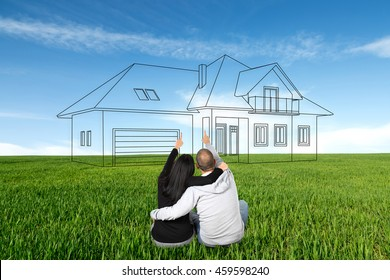 People are dreaming about a new home. Drawn house on the meadow as the preliminary draft.