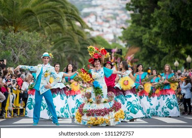 people dressed in colorful clothes at the Festa da Flor or Spring Flower Festival in the city of Funchal on the Island of Madeira in the Atlantic Ocean of Portugal.  Madeira, Funchal, April, 2018