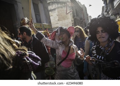 People dressed in different costumes dance during a carnival parade in Athens, Greece, on the 6th of March 2016.