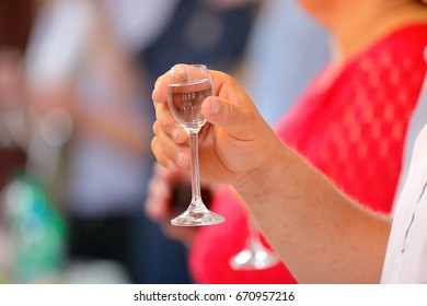 People drink alcohol at a party or wedding reception
