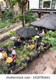 People drinking at Boro Bistro (Authentic French Bistro) a garden-pub venue, outdoor, near London Bridge in London, UK 07/06/2019. This tavern is located in Southwark neighborhood.