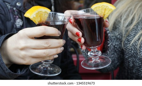 People drinking hot wine enjoy. Business people success celebration party conceptual photography. Toasting with wine glasses. Relaxation and cheers concept. Friends having fun and good time together.
