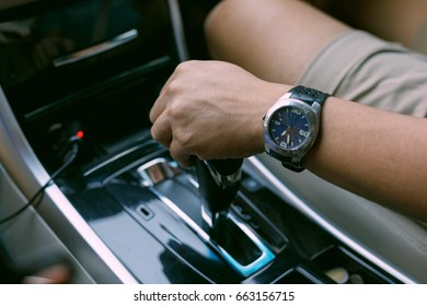 people driving car travel road trip, man hand change automatic gear to go