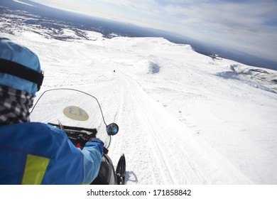 people driving  snowmobile in winter mountain ,china