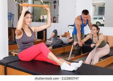 people during workout in the gym with modern fitness equipment