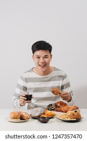 People eating fast food concept hand holding deep fried chicken carbonated soft drink
