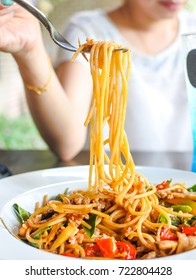 People eating Spicy sea food spaghetti with fork