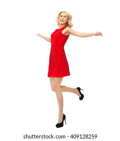 b6ef30d120b5 people, emotion, expression, happiness and holidays concept - happy young  woman in red
