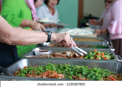 The people are enjoy buffet with blurred background.