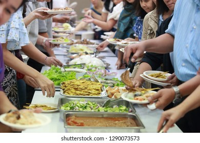 The people are enjoy the buffet food with the asian food with blurred background.