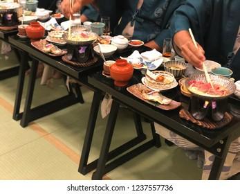"""People enjoy having dinner Japanese food """"Kaiseki set"""" in reunion party at Ryokan, Takayama"""