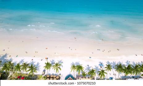 People enjoy summer time at sandy coast line of koh Phangan island,Haad Rin area,Thailand