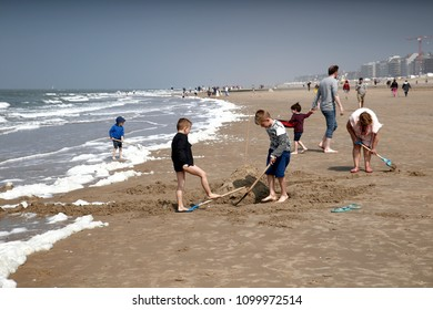 People enjoy the sun on the beach on a very warm day in Knokke-Heist, Belgium on 20 May, 2018