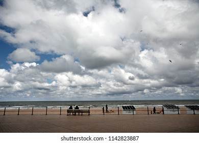 People enjoy the sun on a beach in Ostend, Belgium on April 17, 2016