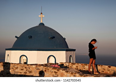 People enjoy the sunset in the Greek island of Astypalaia, in Dodecanese island complex on July 31 ,2017
