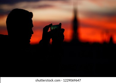 People enjoy the view of Brussels as the sun sets in Brussels, Belgium on Nov. 12, 2018