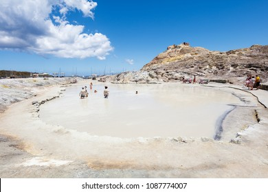 People enjoy volcanic Mud Baths on Vulcano island, Aeolian Islands Sicily Italy, summer 2017