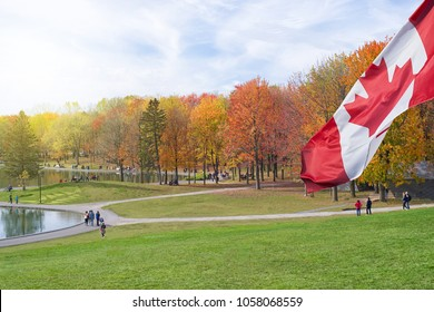 People enjoy a warm autumn day at a park in Canada