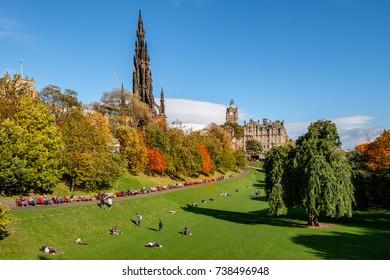 People enjoying the autumn sun in  Edinburgh's famous 'Princess Street Gardens' in mid October.