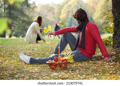 People enjoying autumn time in the park