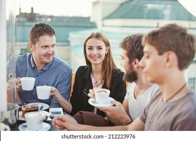 people enjoying coffee together with friends (focus on woman's eyes)