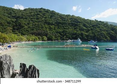 People enjoying day on beach in Haiti
