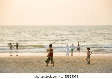 People enjoying evening at Kudle Beach, Gokarna, Karnataka, India in December, 2017