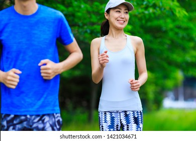 People enjoying jogging in the green of nature