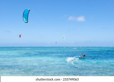 People enjoying kitesurfing on clear blue tropical water, Kume Island, Okinawa, Japan