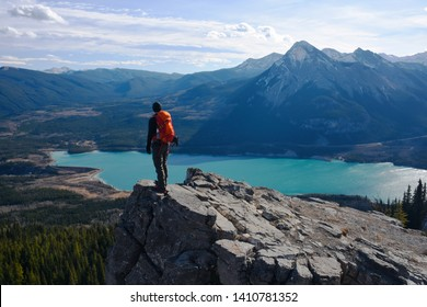 People enjoying the mountain views of the great outdoors, hiking and exploring the trails and valleys of the Canadian Rockies.