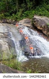 People enjoying Pai waterfall in Thailand. Pai, Thailand. December 1, 2018